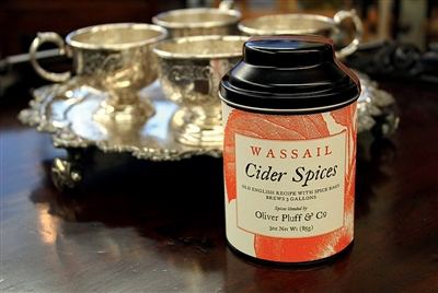 silver cups on silver tray and tin of wassail spices